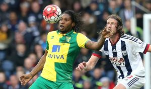 Norwich City's Dieumerci Mbokani battles for the ball with West Bromwich Albion's Jonas Olsson, during the Barclays Premier League match at The Hawthorns, West Bromwich.